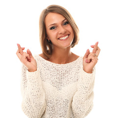 Young and attractive woman crossing fingers