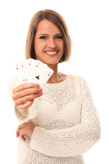Beautiful young girl holding playing cards