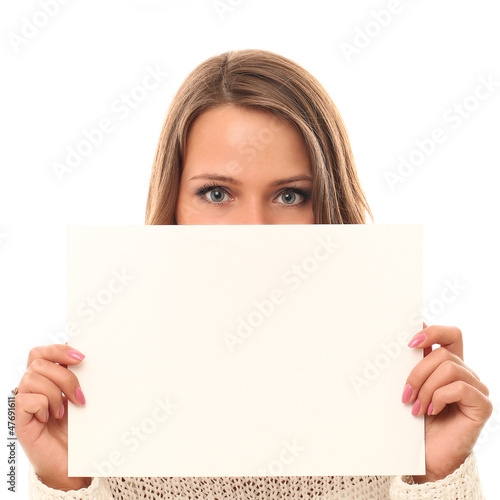 Young smiling woman holding blank paper