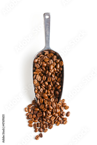 metal scoop with coffee beans