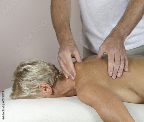 Male therapist treating Trapezius