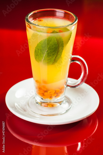 Hot drink with mint and sea-buckthorn