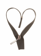 A black zipper is in a heart's form.