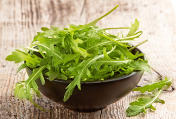 Rucola in black bowl