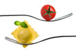 ravioli pasta parcel and basil garnish on fork white background