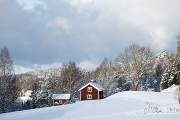 old farm in a snowy winter landscape