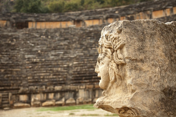 antique stone mask in  amphitheater Myra