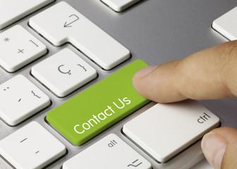 Contact Us keyboard key. Finger