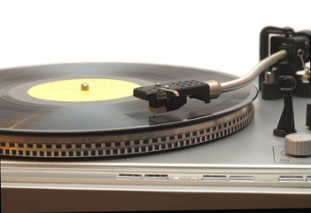 Turntable with vinyl record with yellow label isolated closeup