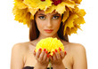 beautiful young woman with autumn wreath and chrysanthemum,