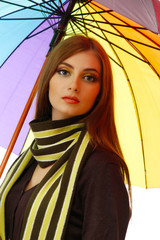 beautiful young woman with colorful umbrella, close up