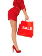 woman on high heels holding shopping bags