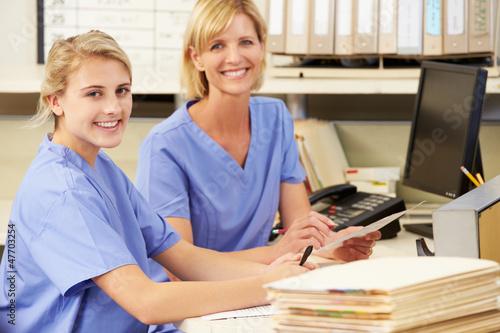 Leinwandbild Motiv Two Nurses Working At Nurses Station