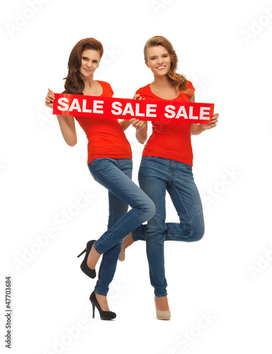 two teenage girls with sale sign