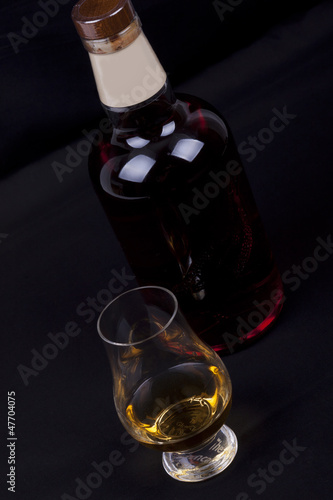 whisky on a black background