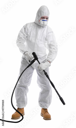 man in full protective clothing using pressure washer