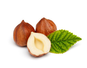 Hazelnuts with leaf isolated on white background