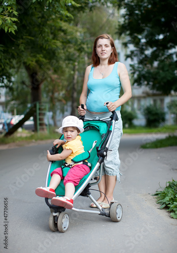 pregnancy woman with stroller