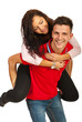 Happy young couple in piggyback