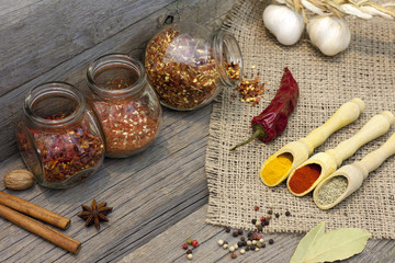 Spices and herbs on old vintage wooden boards in the kitchen