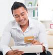 Asian man online shopping