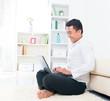 Asian man browsing internet