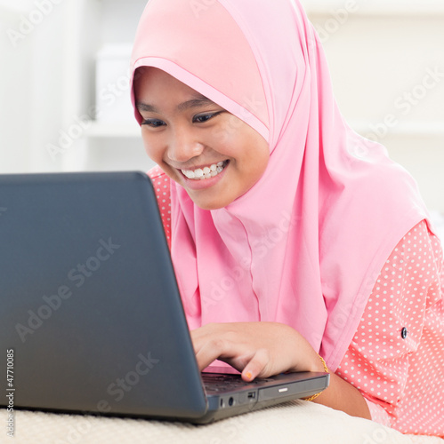 Asian teenager using notebook