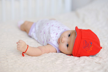 Baby in Red Cap