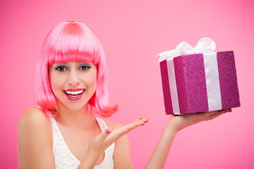 Happy woman holding gift