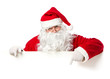 Santa Claus pointing in blank banner