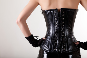 Close-up shot of gothic woman in leather corset