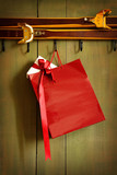 Red shopping bag hanging on hook