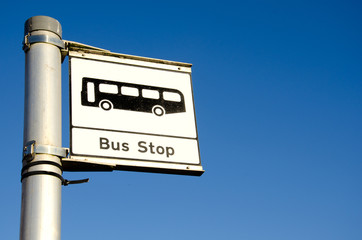 bus stop sign on blue background