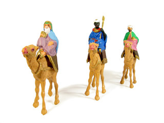 Three Wise Men following a star to Bethlehem