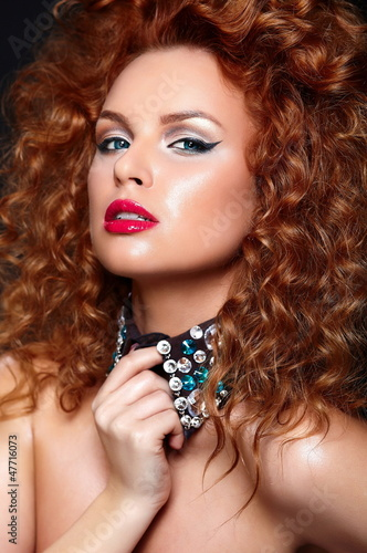 glamor sexy redhead model with red lips,bright makeup
