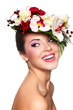 beautiful woman with bright makeup with colorful flowers on head