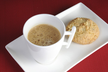 Cup of delicious coffee and biscuits