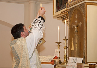 priest with the eucharist at tridentine mass