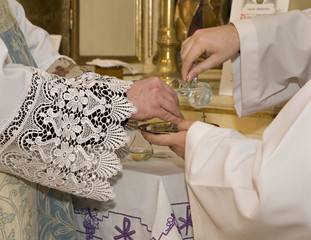 hands of priest by the mass