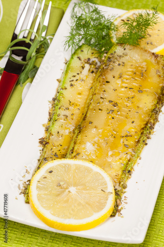 Grilled zucchini with dill on a plate