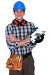 young craftsman holding an electric saw