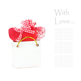 Red and white needlework hearts in a little shopping bag. poster