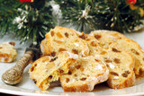 Christmas stollen sliced on white plate