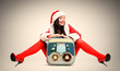 Sexy Santa girl with old tape recorder