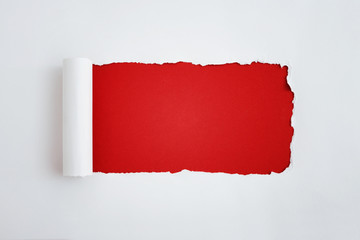 The sheet of torn paper against the red background