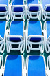 Close up view of blue deck chairs