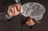 Businessman hand drawing a brain
