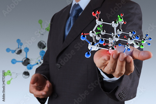businessman holding a molecule