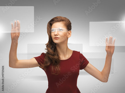 teenage girl working with virtual screen