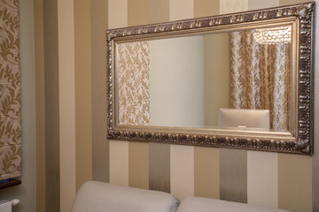 Travertine house - golden mirror